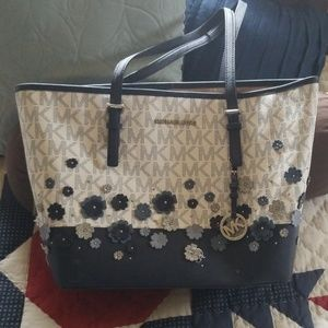 Blue and white purse with flower accents